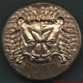 Античная монета Лев и бык