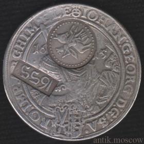 Ефимок с признаком надчекан на талере 1615 года